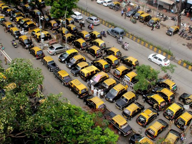 People waiting for a taxi outside CST on Tuesday.