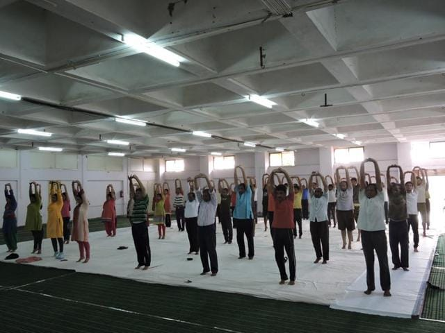 Students perform Yoga at Nutan College in Bhopal.