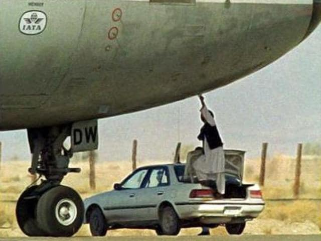 In this picture taken on December 27, 1999, a Taliban security official receives a paper on which the hijackers of the Indian Airlines flight put their demands, at the Kandahar airport.