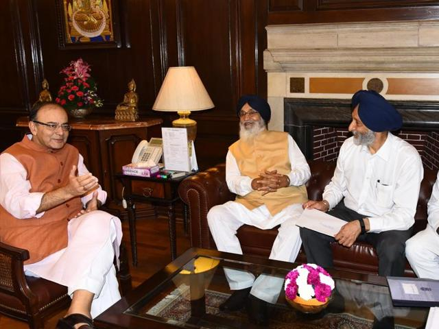 Union finance minister Arun Jaitley (left) with Punjab chief minister Parkash Singh Badal in Delhi on Wednesday.