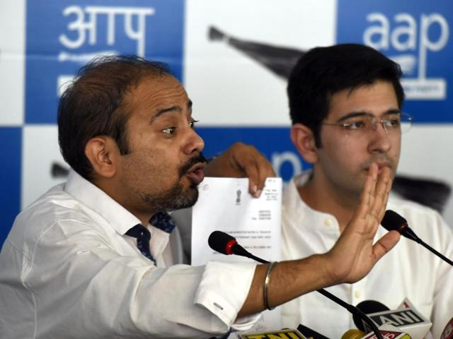Aam Adami Party (AAP) Delhi Unit Convener Dilip Pandey, ( L) Party spokesperson Raghav Chadha,( R) address a Press conference on the issue of NDMA official's murder.