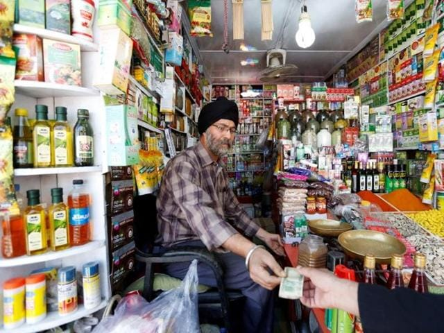 Afghan Sikh Jagtar Singh Laghmani, 50, accepts money from a customer at his traditional herb shop in Kabul, Afghanistan .