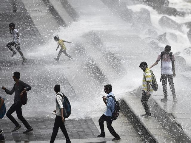 Children enjoy the high tide at Marine Drive on Wednesday.
