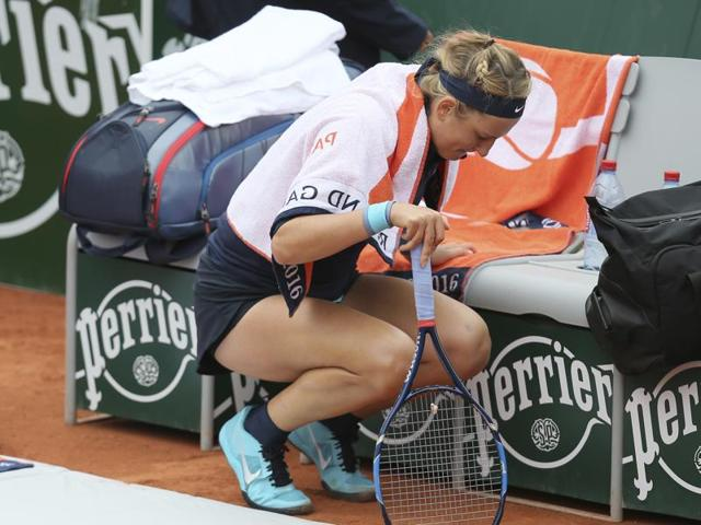 Victoria Azarenka of Belarus after she was treated for an injured right knee during her first round match of the French Open tennis tournament against Italy's Karin Knapp at the Roland Garros stadium in Paris, France.