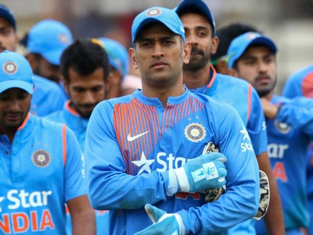 India captain Mahendra Singh Dhoni leads his team after victory during the third and final T20 cricket match.