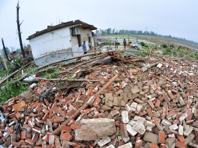 Debris of damaged houses is seen after a tornado hit Funing county, Yancheng, Jiangsu province, China, June 23, 2016.