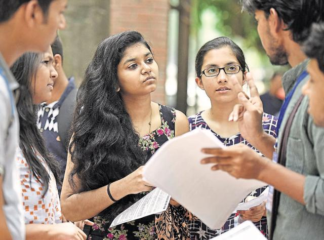 In this file photo, students explain admission-related queries to aspirants at the Delhi University.