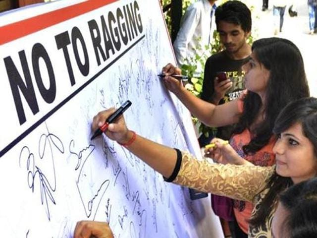Students sign a 'No Ragging' pledge on the first day of new academic year at Hansraj College, New Delhi,  2014