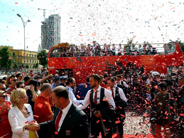 Albania's Euro 2016 squad was welcomed home on Thursday with a formal red-carpet ceremony and National Guard troops on its return from the country's first ever participation at a European Championship.