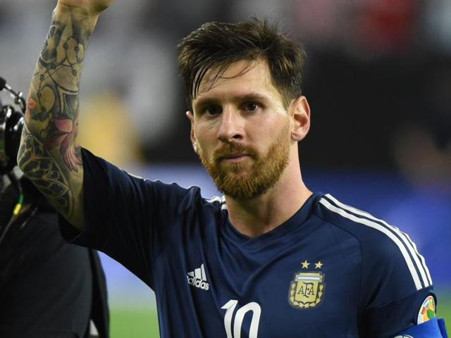 Argentina's Lionel Messi (R) is marked by USA's DeAndre Yedlin during their Copa America.
