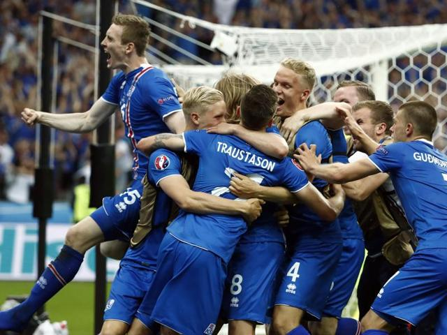 Iceland's players celebrate after the Euro 2016 group F football match between Iceland and Austria at the Stade de France stadium in Saint-Denis, near Paris.