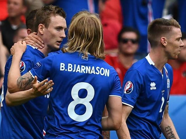 Iceland's forward Jon Dadi Bodvarsson (L) celebrates with teammates after scoring during the Euro 2016.