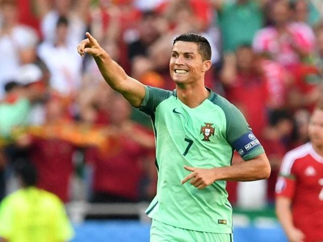 Portugal's forward Cristiano Ronaldo celebrates after scoring a goal during the Euro 2016 group F football match between Hungary and Portugal at the Parc Olympique Lyonnais stadium in Decines-Charpieu, near Lyon.