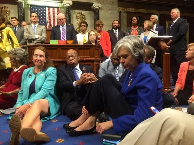 A photo shot and tweeted from the floor of the US House of Representatives by US House Rep. Katherine Clark shows Democratic members of the House staging a sit-in on the House floor 'to demand action on common sense gun legislation'.