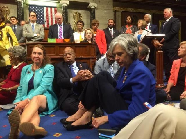 A photo shot and tweeted from the floor of the US House of Representatives by US House Rep. Katherine Clark shows Democratic members of the House staging a sit-in on the House floor