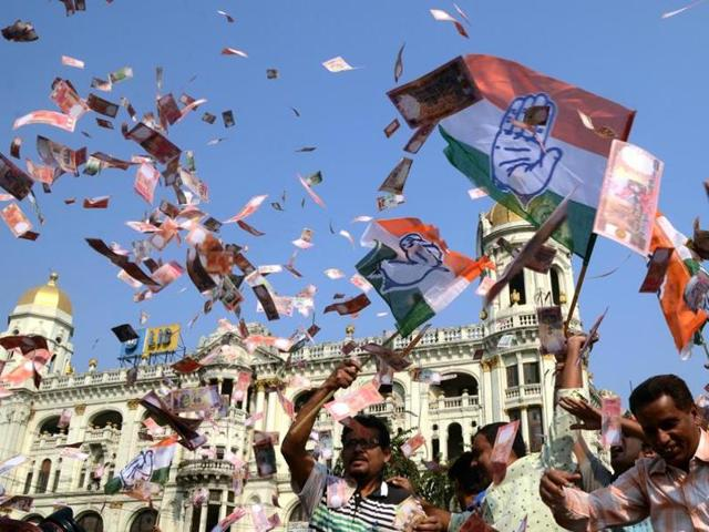 Congress workers blow fake Indian currency at Esplanade in Kolkata on March 15 to protest in support of the Narada sting operation, which showed TMC leaders taking bribes.