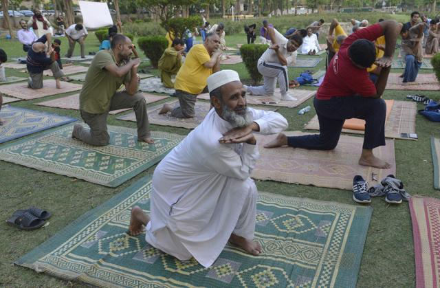Pakistani people take part in a yoga session to mark International Yoga Day in Lahore on June 21, 2016.