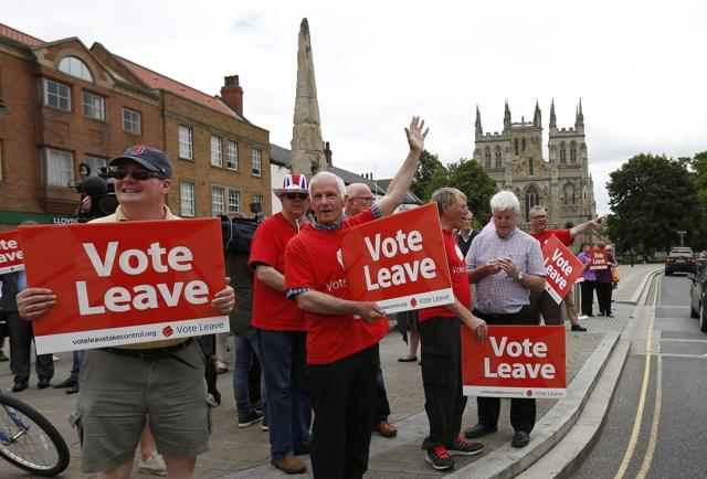 Supporters hold banners as former London Mayor Boris Johnson attends a