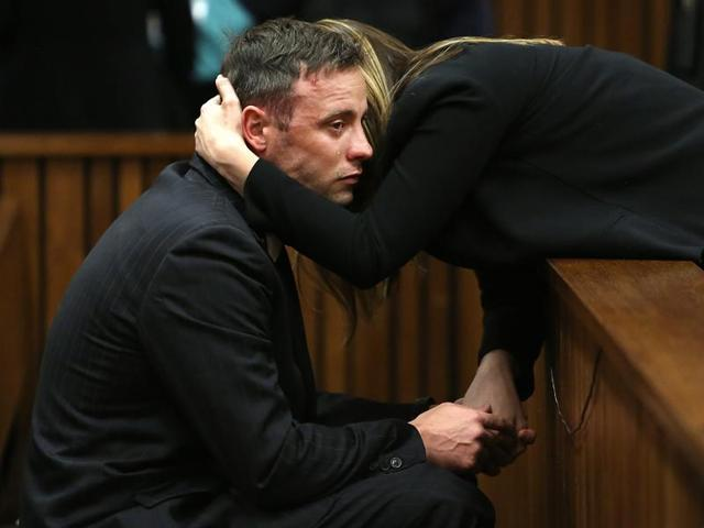 South African Paralympian Oscar Pistorius reacts as his sister holds him during the third day of his resentencing hearing for the 2013 murder of his girlfriend Reeva Steenkamp at the Pretoria high court.