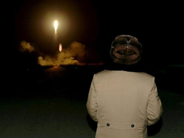 North Korean leader Kim Jong Un watches the ballistic rocket launch drill of the Strategic Force of the Korean People's Army (KPA) at an unknown location, in this undated file photo released by North Korea's Korean Central News Agency (KCNA) in Pyongyang on March 11, 2016.
