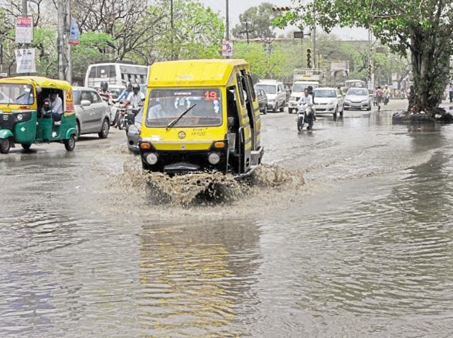Intense waterlogging on a city road after first monsoon showers on Thursday.