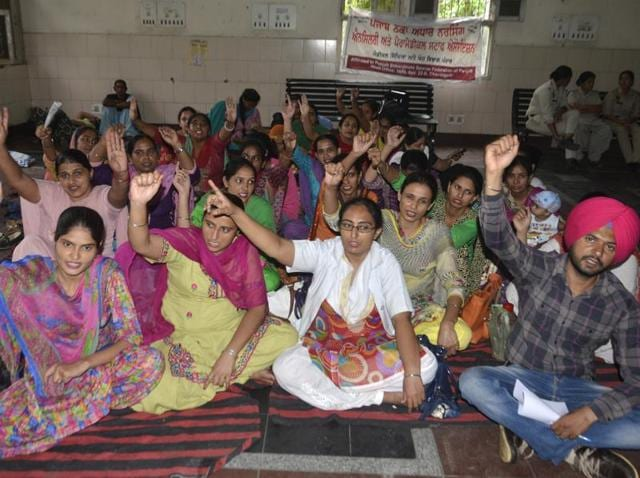Contractual paramedical and nursing staff protest against authorities for regularisation of jobs at Guru Nanak Dev Hospital in Amritsar on Wednesday.