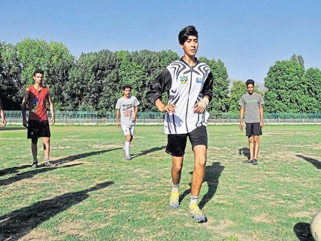 Nadiya Nighat, Kashmir's first woman football coach and referee seen training young players in Srinagar.