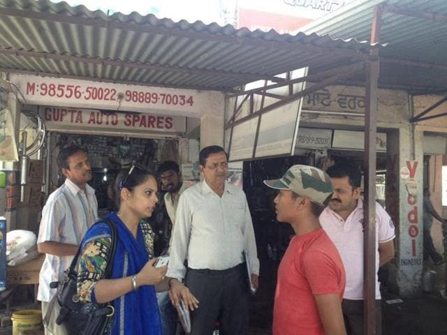 District child protection officer Harpreet Kaur Sandhu and other labour department officials interacting with a child labourer in Kapurthala.
