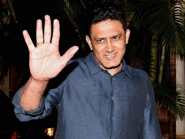 Newly appointed Indian Cricket Team Head Coach Anil Kumble gestures at his residence in Bengaluru.