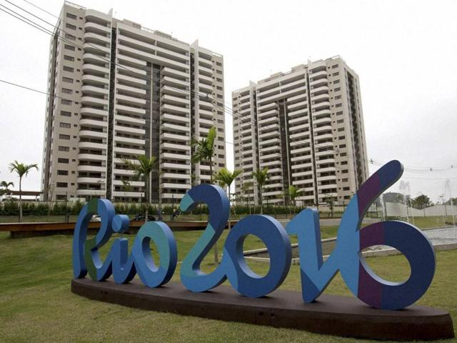 The Rio 2016 sign stands in front of the Olympic Village during a media tour in Rio de Janeiro, Brazil.