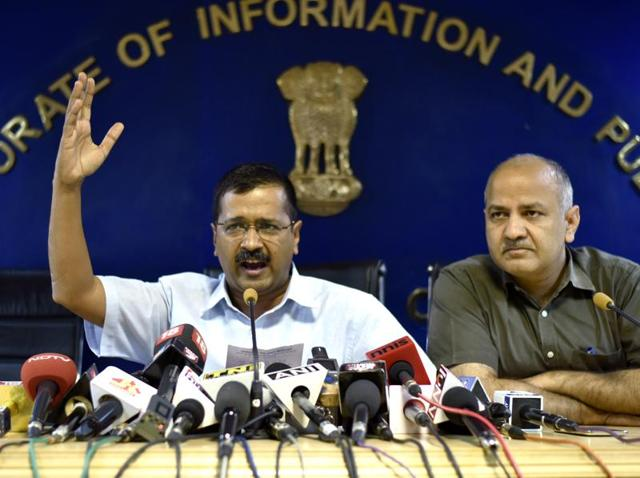Delhi chief minister Arvind Kejriwal and deputy CM Manish Sisodia interact with journalists at a press conference.