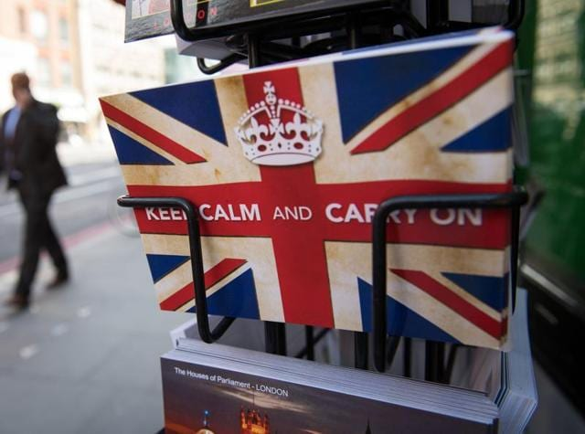"Postcards featuring the World War II British slogan ""Keep Calm and Carry On"" are seen outside a newsagents in London. Britain voted to break away from the European Union, toppling Prime Minister David Cameron and dealing a thunderous blow to the 60-year-old bloc that sent world markets plunging."