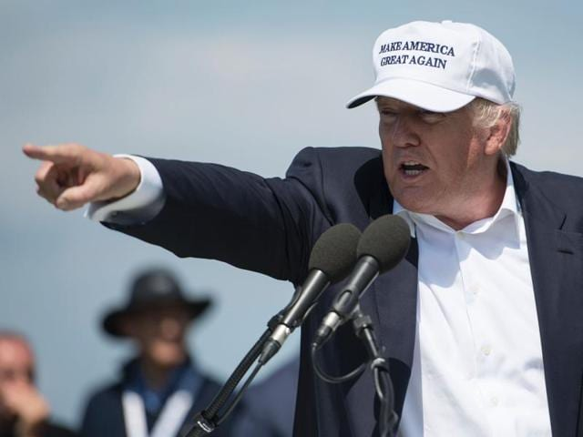 Presumptive Republican presidential nominee Donald Trump delivers a speech as he officially opens his Trump Turnberry hotel and golf resort in Turnberry, Scotland.