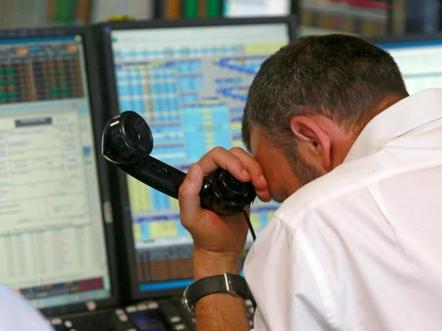 A trader from BGC, a global brokerage company in London's Canary Wharf financial centre reacts during trading after Britain voted to leave the European Union in the EU Brexit referendum.