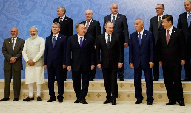 Prime Minister Narendra Modi, Afghan President Ashraf Ghani (L), Kyrgyz President Almazbek Atambayev(2nd L), Russian President Vladimir Putin (3rd R), China's President Xi Jinping (R) pose for a group photo with other leaders at The Shanghai Cooperation Organization (SCO) Heads of State Council meeting, in Tashkent on Friday. China has been opposing India's bid to be included in the NSG.