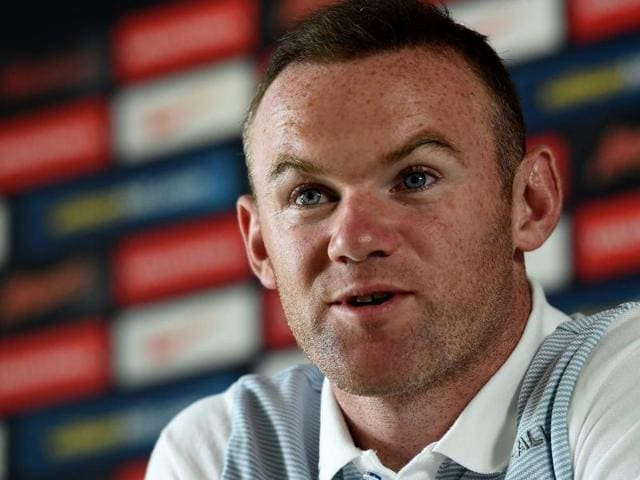 England forward Wayne Rooney gives a press conference in Chantilly.