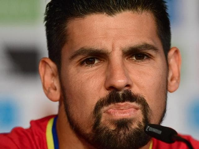 Spain's forward Nolito arrives to hold a press conference at Saint-Martin-de-Re's stadium.