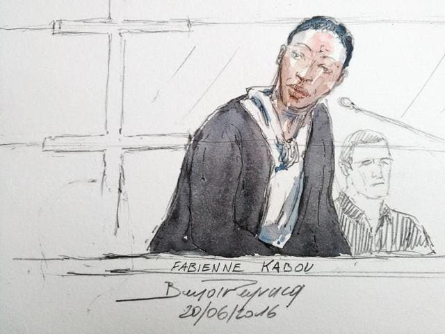 This court sketch made shows Fabienne Kabou speaking during the first day of her trial at the Assize Court, in Saint-Omer.