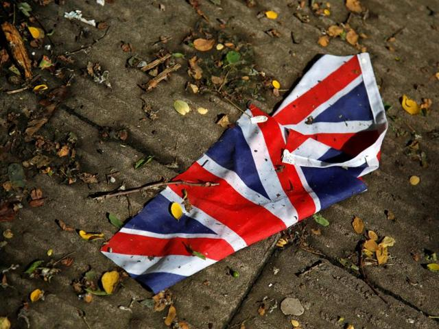 A British flag which was washed away by heavy rains the day before lies on the street in London after Britain voted to leave the European Union.