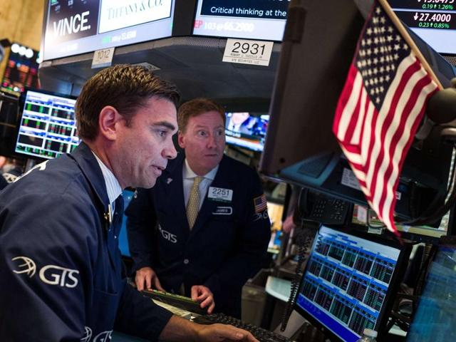 Traders and financial professionals work on the floor of the New York Stock Exchange on Thursday  in New York City. Financial markets are bracing for the outcome of Thursday's historic 'Brexit' referendum.