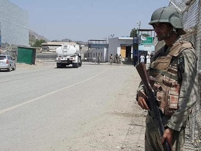 Afghan border police stand guard near the Torkham crossing between Afghanistan and Pakistan. Torkham, the main crossing between the two sides was closed by Pakistani authorities on May 9, with hundreds of Afghan civilians attempting to get to Pakistan waiting in the open for several days.
