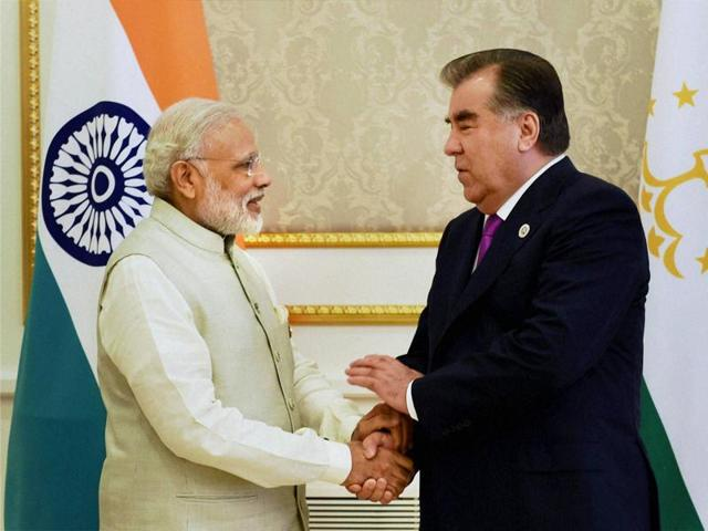 Prime Minister Narendra Modi shakes hands with Tajik President Emomali Rahmon in a meeting in Tashkent on Friday.