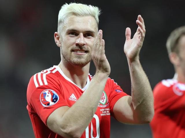 Wales's Aaron Ramsey, left, salutes fans after the Euro 2016 Group B match between Russia and Wales.