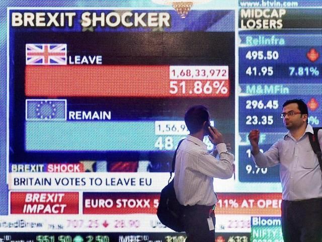 Stock brokers in front of screen outside the Bombay Stock Exchange which displays Brexit shocker in Mumbai on Friday.