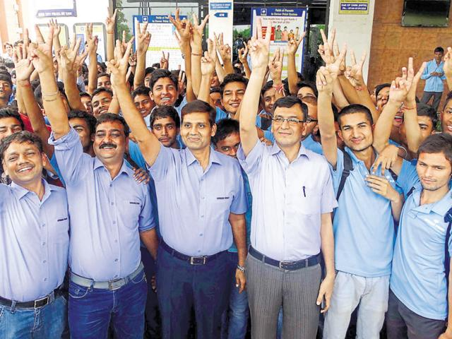 Students and teachers in Kota share a light moment after the JEE Mains rankings were declared.