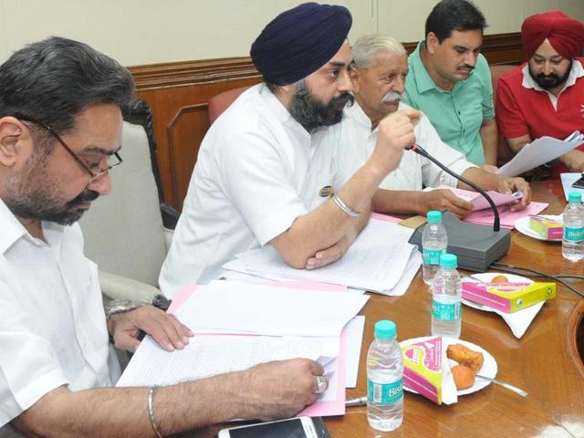 Mayor Amarinder Bajaj addressing a meeting at municipal corporation office in Patiala on Thursday.