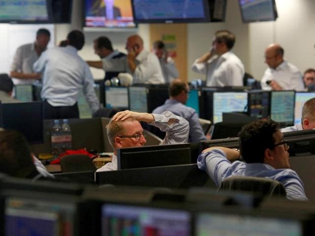 Traders from BGC, a global brokerage company in London's Canary Wharf financial centre react as European stock markets open early June 24, 2016 after Britain voted to leave the European Union in the Brexit referendum.