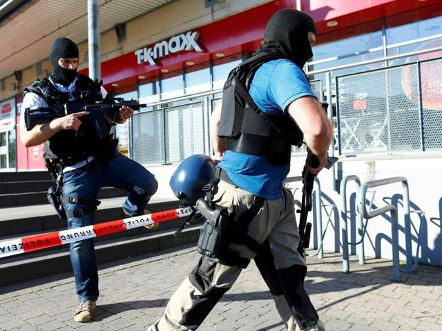German special police walks past a cinema complex after a masked man with a gun and ammunition belt opened fire in Viernheim near Frankfurt on Thursday.