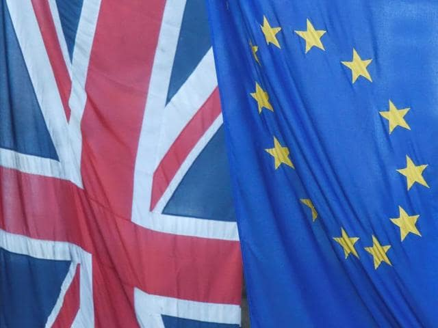 A Union flag flies next to the flag of the European Union in Westminster, London.