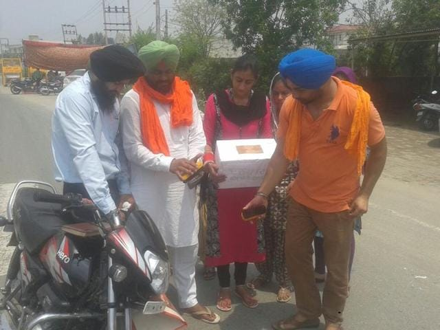 Economic and statistical department employees polishing shoes in Sangrur on Friday.